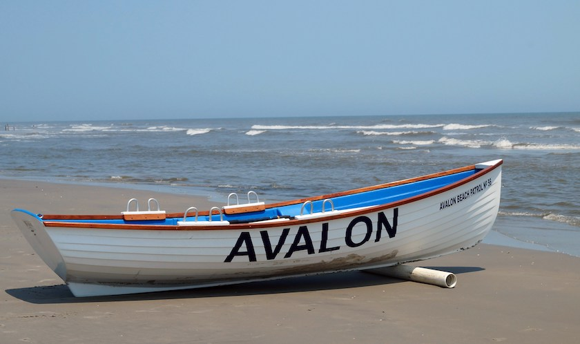 a boat on the shore printed with Avalon