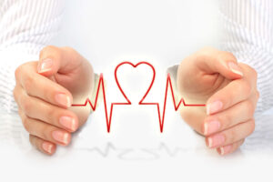 white hands holding a pulse shaped as a heart