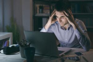 man at work feeling stressed