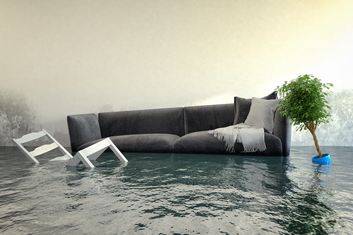 flooded living room with couch and chair under water